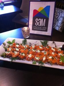 Dish of food and a SAM sign