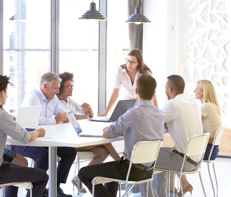 Group meeting around table, Corporate Coach, Calgary, AB