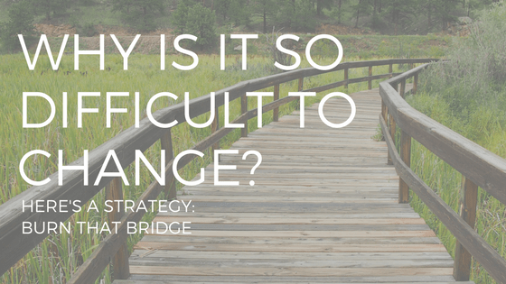 WHY IS IT SO DIFFICULT TO CHANGE (text) over a picture of a bridge