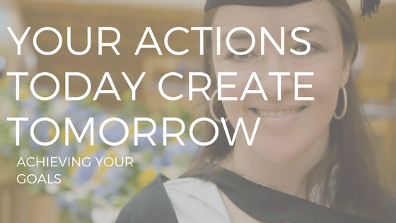 """THE TEXT """"ACHIEVING GOALS"""" OVER A WOMAN WEARING A MORTAR BOARD AND GRADUATION GOWN"""