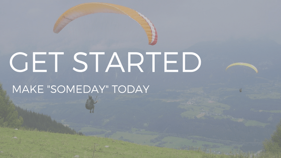 "THE TEXT ""GET STARTED"" OVER THE IMAGE OF TWO PEOPLE PARAGLIDING IN THE MOUNTAINS"