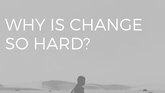WHY IS CHANGE SO HARD- over a photo of a man carrying a guitar