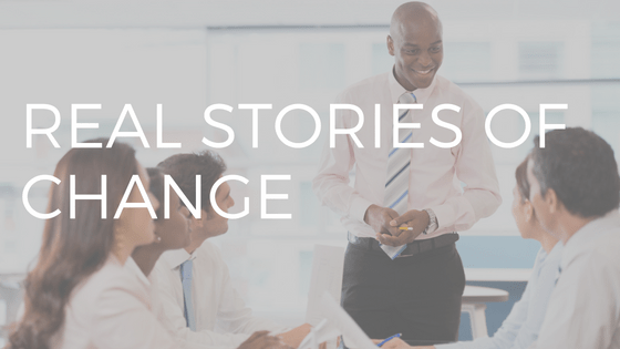 "TEXT ""REAL STORIES OF CHANGE"" OVER PHOTO OF A MAN PRESENTING TO A GROUP"