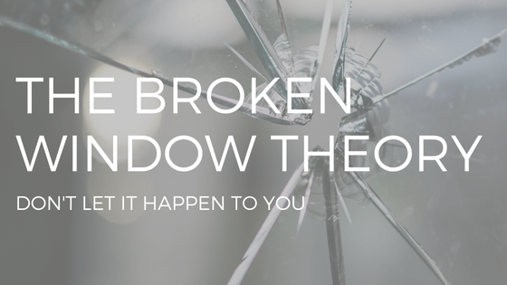 "THE TEXT ""BROKEN WINDOW THEORY"" OVER PHOTO OF CRACK IN WINDOW PANE"