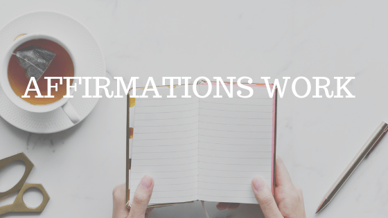 "a flat lay photo of a woman's hands holding a journal beside a cup of coffee with white text reading ""affirmations work"""