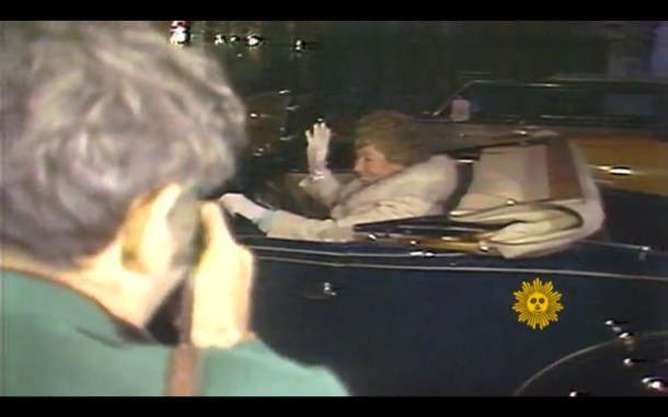 Harriet Stratemeyer Adams arrives in the back of a blue roadster.