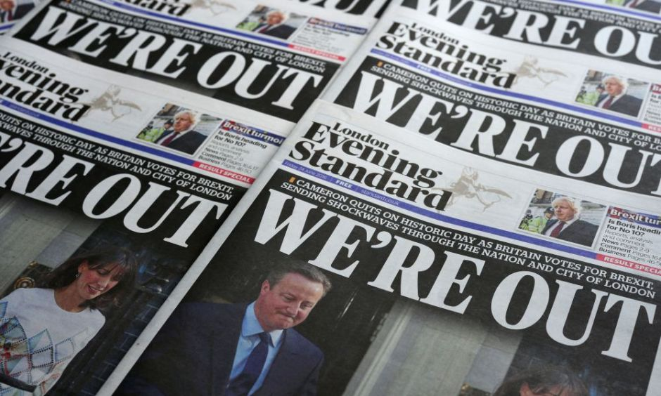 An arrangement of newspapers pictured in London on June 24, 2016, as an illustration, shows the front page of the London Evening Standard newpaper reporting the resignation of British Prime Minister David Cameron following the result of the UK's vote to leave the EU in the June 23 referendum. Cameron is pictured holding hands with his wife Samantha as they come out from 10 Downing Street. Britain voted to break away from the European Union on June 24, toppling Prime Minister David Cameron and dealing a thunderous blow to the 60-year-old bloc that sent world markets plunging. / AFP / Daniel SORABJI        (Photo credit should read DANIEL SORABJI/AFP/Getty Images)