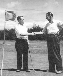 D.R. Crawford (left) shakes hands with Mike Kolomy after defeating Kolomy in the 1943 final