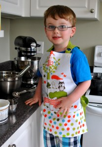 Toddler in apron