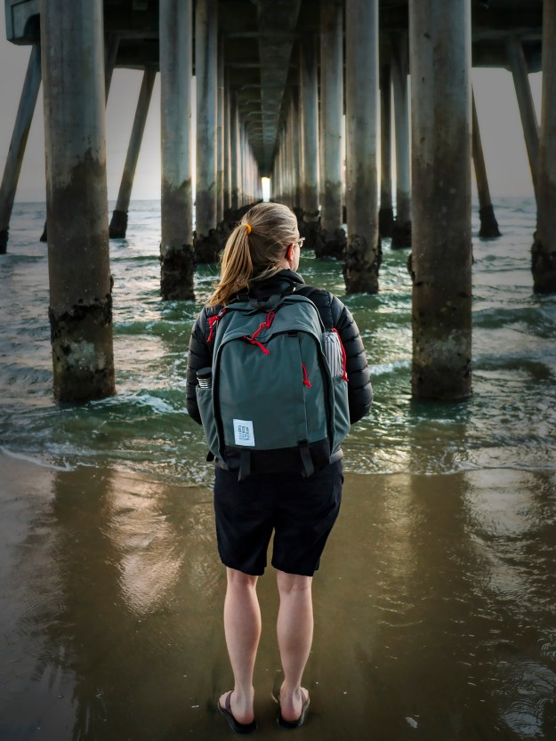 Topo Designs Core Pack under the pier at Huntington Beach