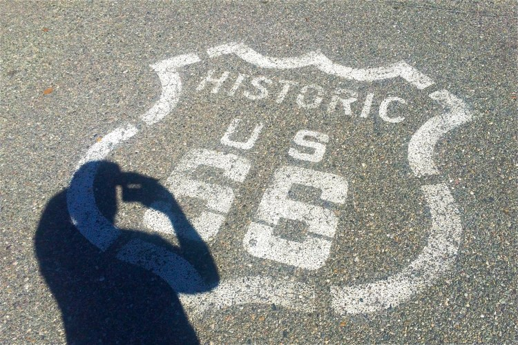 The younger shadow of myself soaks in all the memories of my childhood when we drove Route 66 back east every summer to visit family.