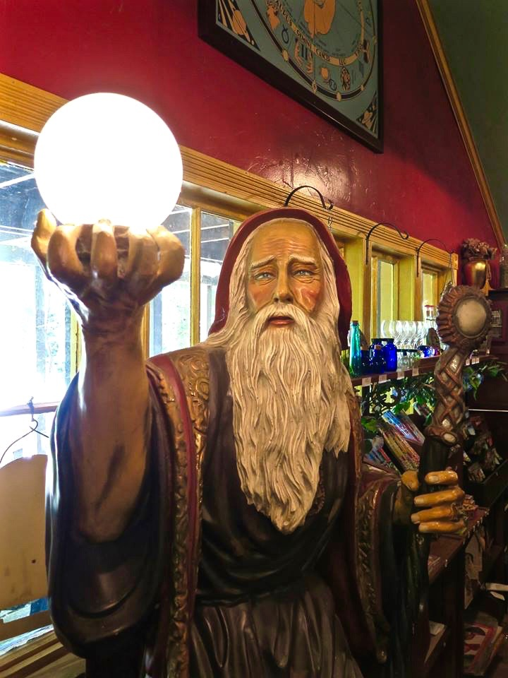 "They also had a couple of oddities that she wanted to tell us about. There was Dusty, the six-foot tall, extremely life-like wizard sculpture who stands just inside the doorway at the entrance to the shop. In his upraised right hand he holds a softly glowing crystal ball. This has earned him the title of ""largest night-light in Forestville."""