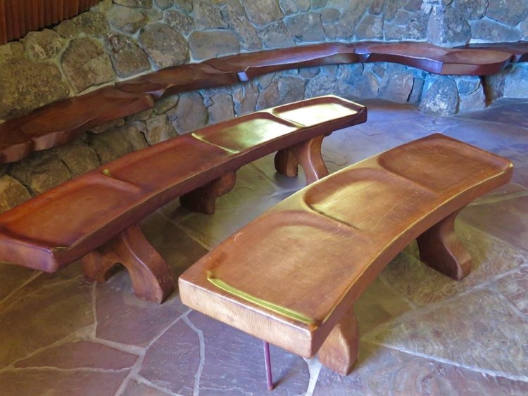 Local redwood was used for the seating, which is carved rather than installed as boards.