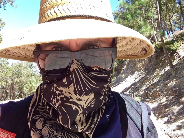 You should never hike in this area during the summer, it gets super hot and there's so many bugs flying around your face during the hike that it forces you to wear things like this.