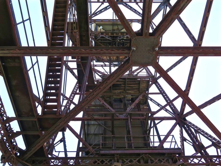 The huge steel head frame whose pulleys guided the miners one mile down into the bowels of the earth.