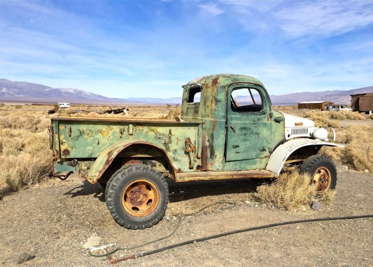 a grim piece of America's past: a green-and-white truck used by the Manson family when they were camping out at Barker Ranch. The headlights had been smashed into blind, sinister eyes. Time and scorching winds had eaten bullet-like holes into the rusting metal.