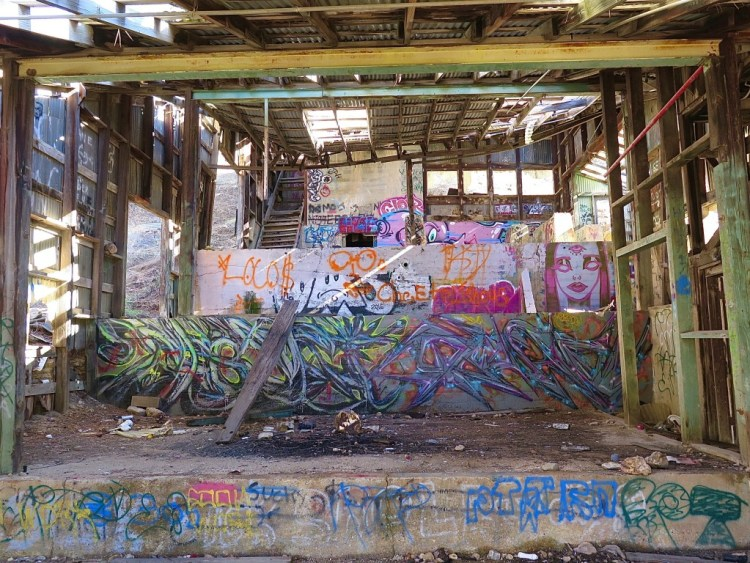 The heavily graffitied machinery foundations inside the ore processing building,