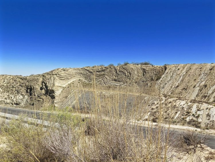 A view of the Pliocene Anaverde Formation (an old sag pond deposit formed only 2 million years ago) all crumpled and folded like a huge collapsed carpet by the pressure of the fault zone just to the south.