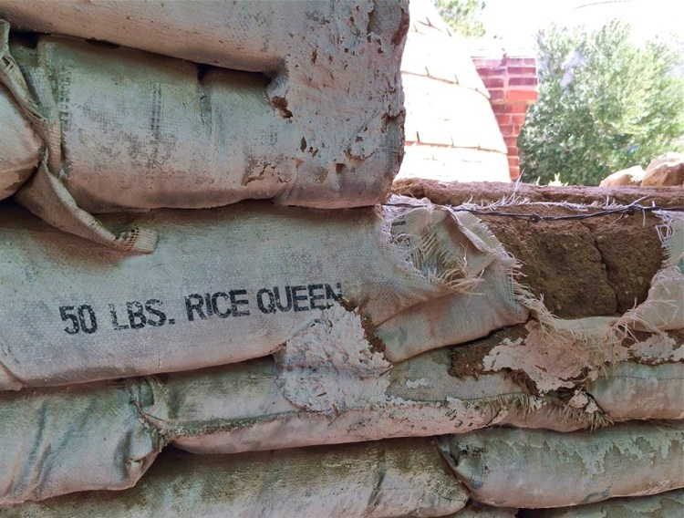 Notice the barbed wire used for stability in this 'Rice Queen' adobe.