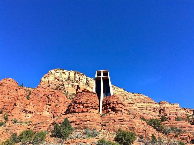 The Chapel of the Holy Cross is a Roman Catholic chapel built into the buttes of Sedona, Arizona. The chapel was inspired and commissioned by local rancher and sculptor Marguerite Brunswig Staude, who had been inspired in 1932 by the newly constructed Empire State Building to build such a church. After an attempt to do so in Budapest, Hungary (with the help of Lloyd Wright, son of noted architect, Frank Lloyd Wright) was aborted due to the outbreak of World War II, she decided to build the church in Sedona, AZ.