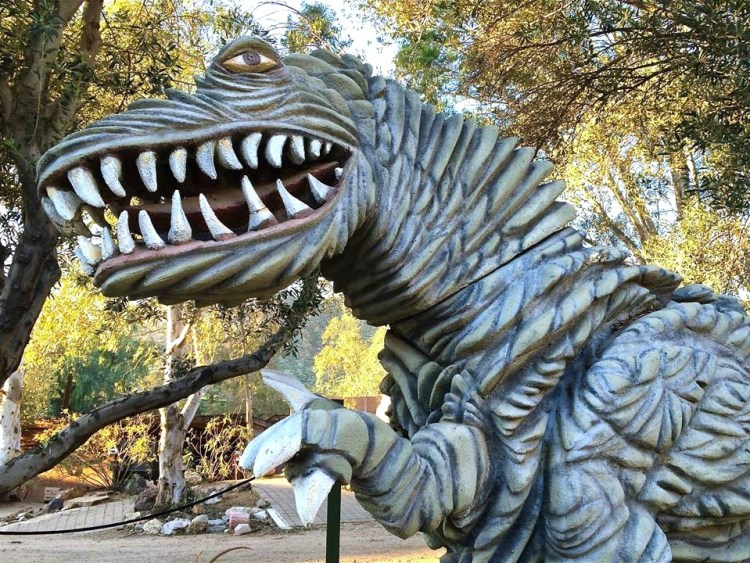 The rustic complex is home to about 22 life-size dinosaurs made of steel or fiberglass that skulk along trails and in the cactus garden and greet visitors at the front gate.