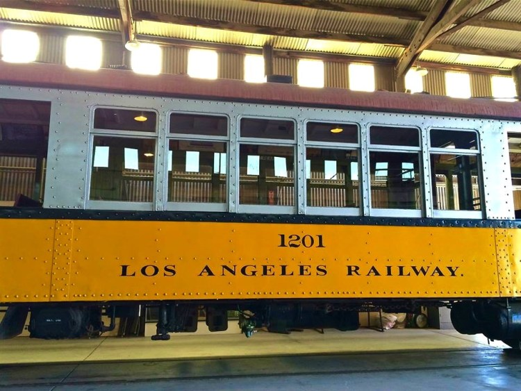 "LARy-1201 was the first of 250 ""Type H"" streetcars; the Los Angeles Railway's first steel-bodied double-truck cars. The Type H cars were built with the familiar ""California style"" open/closed/open architecture of the earlier wooden designs, and had Spartan interiors with wooden slat seating."