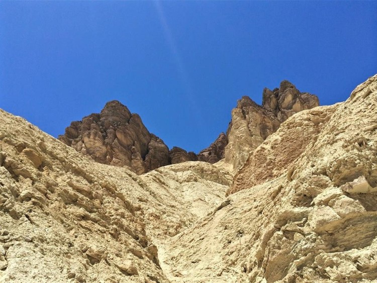 s you make your way into the canyon, pay close attention to the rock walls surrounding you – you can see them change as you hike, from water-polished volcanic rock to the twisted and folded sedimentary rocks left over from the ancient bed of Lake Manly.