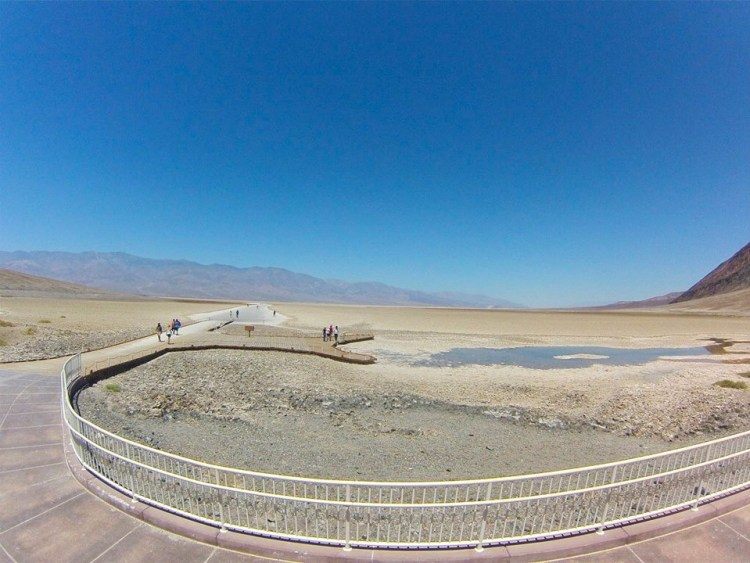 "Badwater consists of a small spring-fed pool of ""bad water"" next to the road in a sink; the accumulated salts of the surrounding basin make it undrinkable, thus giving it the name."