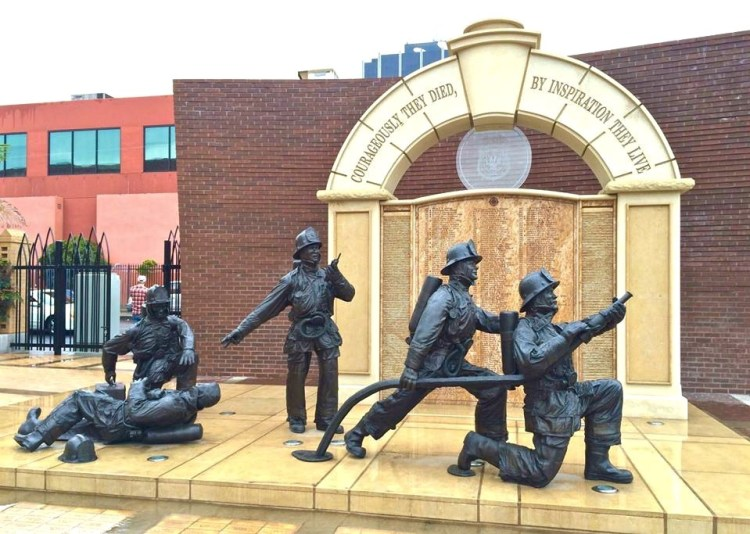 The memorial also includes a series of life-size bronze statues depicting five firefighters. Two of the firefighters are depicted attacking a fire, while a fallen firefighter is attended to by a fourth figure. The fifth figure is the fire captain, shown making a command decision and also caring for the downed firefighter.