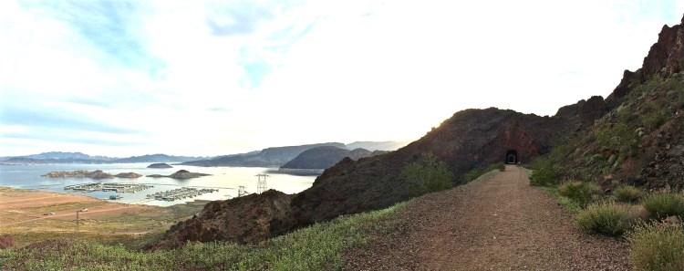 As the trail curves toward the edge of Lake Mead, you'll find yourself several hundred feet above the grey blue water.
