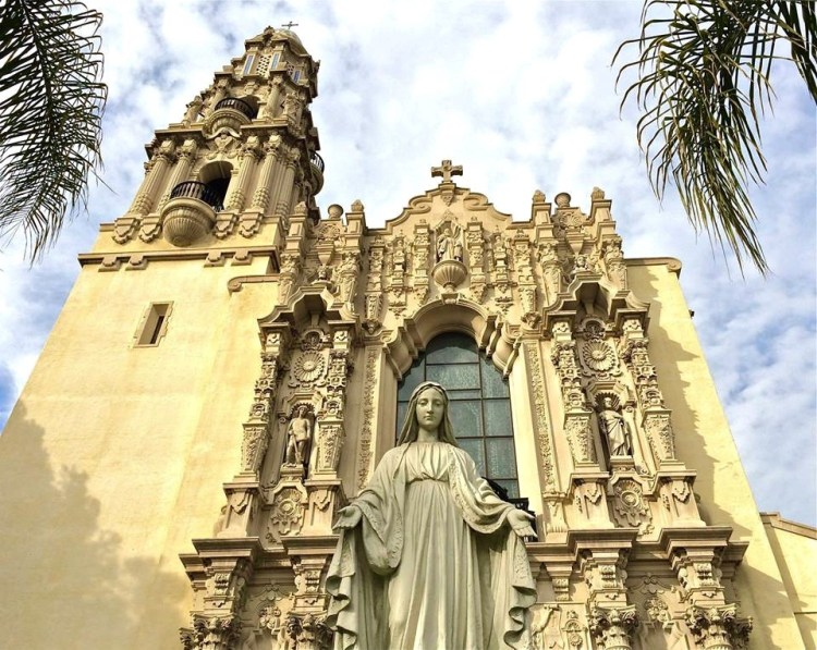 The church located near USC, was built in the 1920s and designed by architect Albert C. Martin. Dedicated in 1925, it was located in what was then one of the wealthiest sections of the city, on land adjacent to the Edward Doheny Mansion and Stimson House.