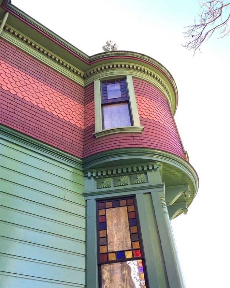 "This multi-colored, turreted, upper-middle class house has been called ""picturesque eclectic,"" and is a mixture of the Queen Anne and Eastlake styles of architecture."