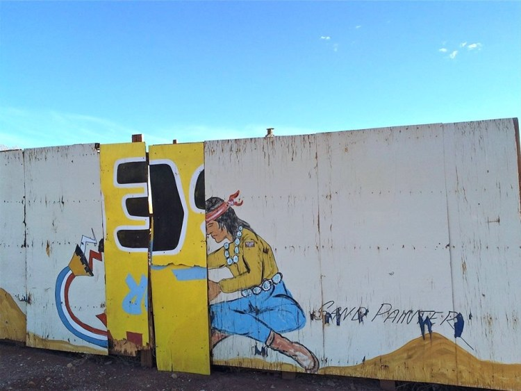 The Indian murals that line the wall facing the interstate still look good after all these years.