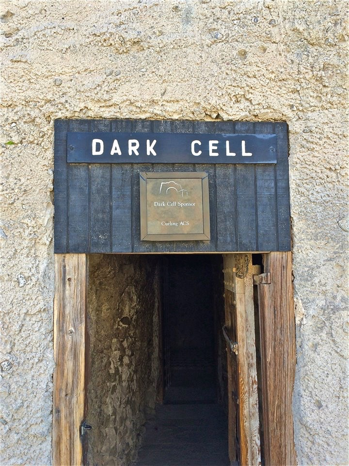 "Most prisoners shuddered at the mention of ""the dark hole,"" a cave measuring 15 x 15 feet, dug into a rock hill, with a strap iron cage in the middle"