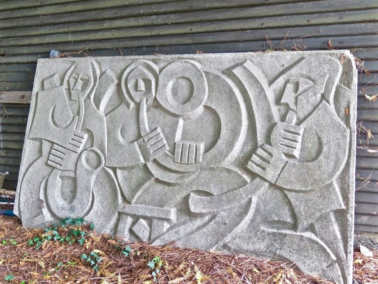 This relief was found far away from the theater, all alone, propped up against a derelict building. Hopefully its weight will discourage theft.