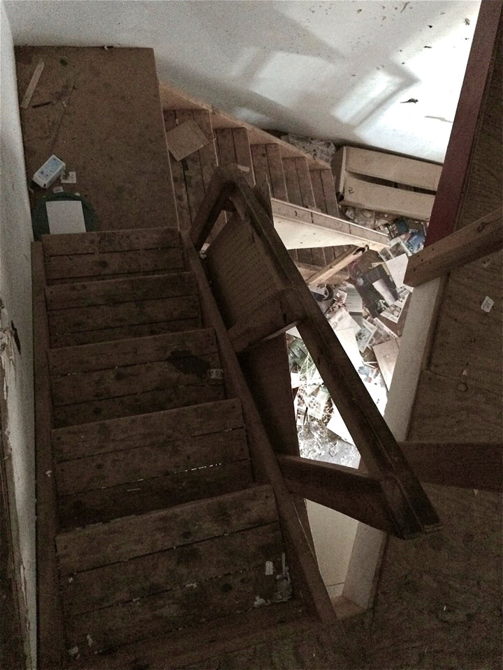 Stairway to second floor balcony that was used as an office.