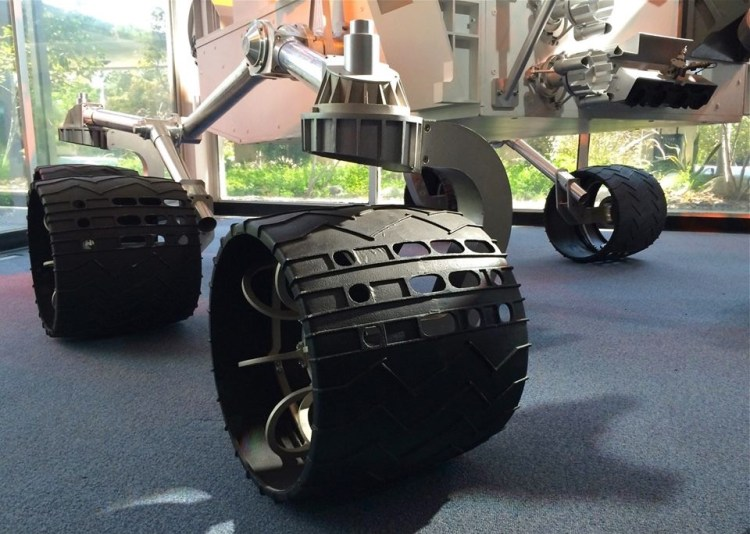 "Back in 2007 when the Curiosity team was putting together the rover, its wheel cleats had a raised pattern with the letters ""JPL,"" leaving a little stamp of the rover's birthplace everywhere it rolled. NASA made them change the pattern since they didn't want to piss off any of the other groups that helped build the rover. So what did JPL do? They put holes in the wheel cleats that now stamp a pattern in the martian soil that is Morse code for JPL."
