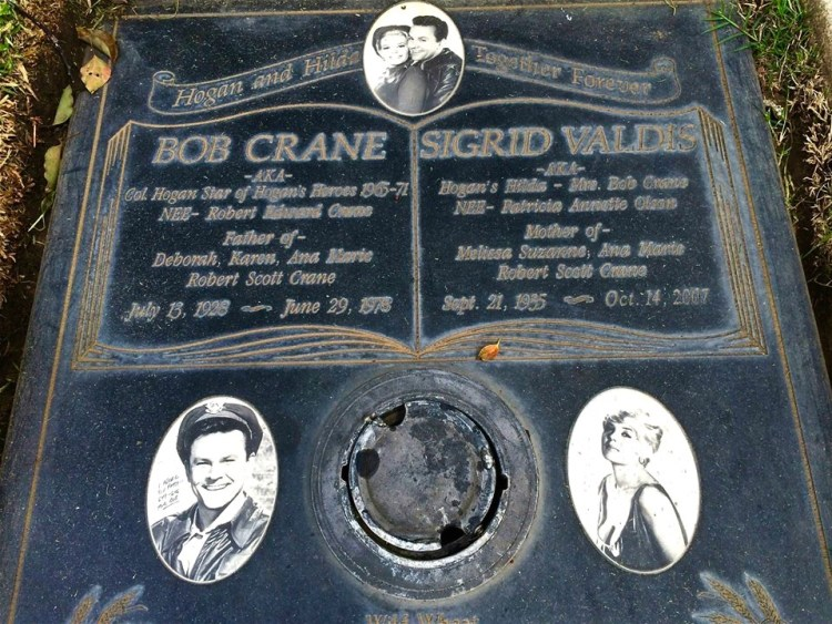 "Bob Crane (1928-1978) was murdered back in 1978 in Scottsdale, Arizona. His controversial private life and his unsolved murder, were dramatized in the 2002 movie ""Auto-Focus"". Originally buried out at Oakwood in the Valley, Bob was moved to Westwood in 1999. His grave was unmarked until 2003, but it now has a beautful marker, black & white stone, with photos of Bob and his wife, Sigrid Valdis, the blonde actress who played Col. Klink's secretary 'Hilda' on ""Hogan's Heroes"". The two were married on the set of the TV show back in 1970. The marker reads ""Hogan and Hilda - Together Forever."""