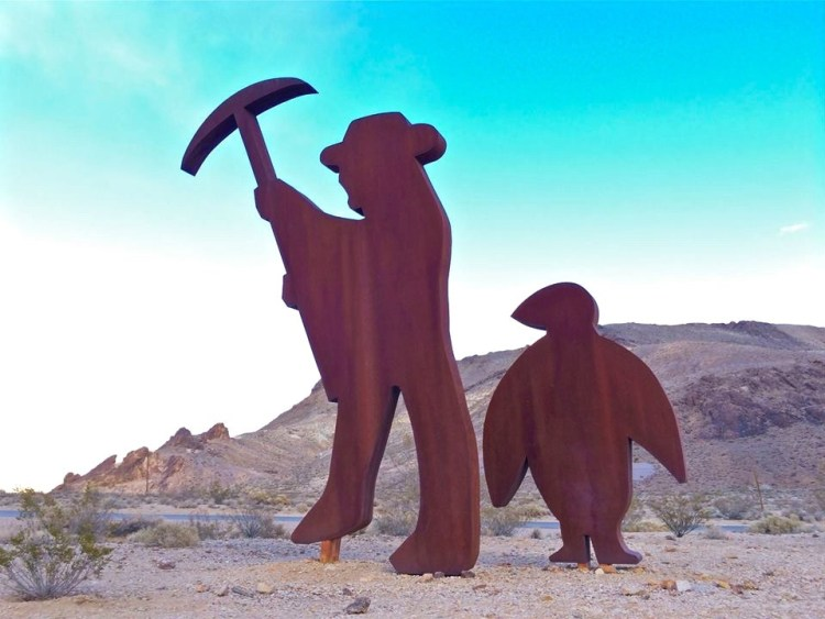 """'Tribute to Shorty Harris' by FRED BERVOETS Among the artists that have contributed work to the museum, probably the one who felt most out of place in the desert was Belgian artist Fred Bervoets, appointed a Knight of the Order of Leopold II by the King in 1988. His """"portrait"""" sculpture of Shorty Harris (an early miner in Death Valley and its environs) and a penguin has elicited countless questio... See More"""