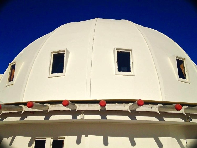 Every visitor to the Integratron is on some level a pilgrim: It's not a place that you just happen by. To reach the building, you wend through a sun-strafed landscape of Joshua trees and bare-rock outcroppings on a series of progressively smaller roads. Finally you spot it: a bright white dome jutting out from the dust that can at first glance appear to be a mirage — a U.F.O. that has touched down on the Mojave moonscape. The building's brilliant whitewashed facade is not merely decorative, it's adhesive. The Integratron was constructed without nails, screws, flashing or weather stripping.