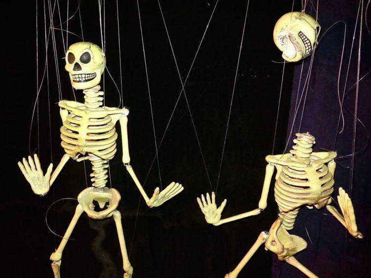 skeletons dancing in the La Brea Tar Pits,