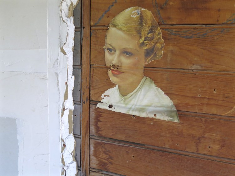 Decoupage near the front door of another abandoned