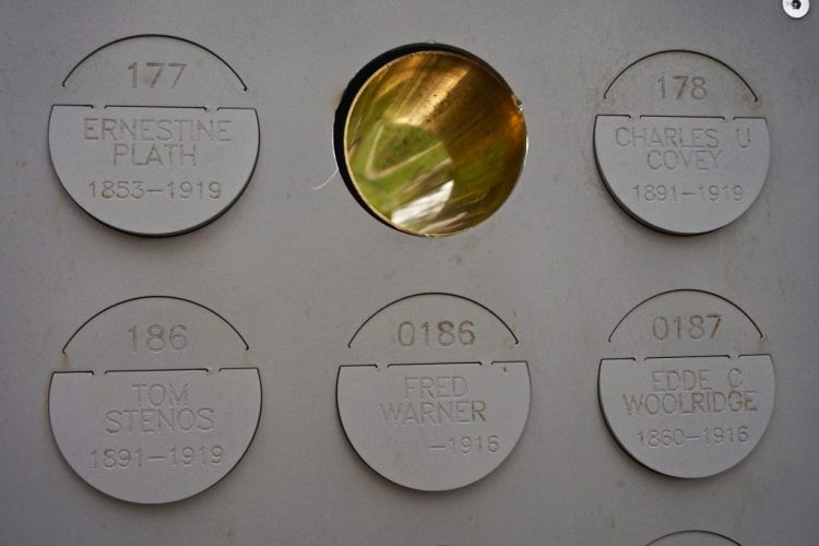 The columbarium wall is made from sandblasted metal turned a soft matte from weather. The ashes from the copper urns were transferred into ceramic canisters and placed in the columbarium wall. The niche of each urn is engraved with a number, name and, if known, both birth and death dates. The urns were handmade by the artists during a three-month residency at the Kohler Company in Sheboygan, Wisconsin. A single empty ceramic urn is visible in a corner of the courtyard to recognize the patients who were ordered exhumed from Asylum Cemetery and cremated, but whose where - abouts are unknown. * In years to come more families will come to claim their relatives. As each claim is made, the family takes home both the ceramic urn and the empty copper urn. Some have even chosen to let them rest in peace with the hope that others will continue to visit them here for generations to come. When the ceramic urns are removed they are replaced by a hollow brass tube that represents the increasing significance of reunited families. As the golden perforations increase the transparency of this once solid wall it is hoped that the evolving appearance communicates the gradual closure of this important piece of Oregon history.