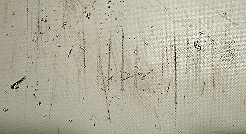 パン切りナイフをアルミホイルで研いだ後のまな板.jpg