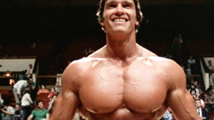 Arnold Schwarzenegger pumps himself up for success in George Butler's documentary 'Pumping Iron.'