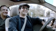 Jafar Panahi in the driver's seat of 'Taxi' from Iran