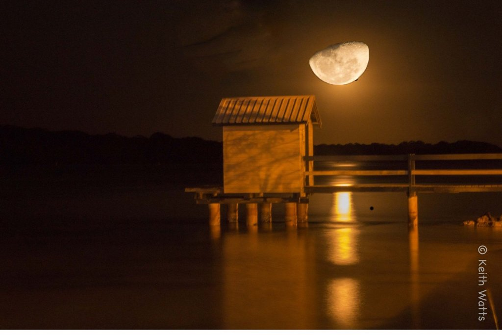 Moon on boathouse