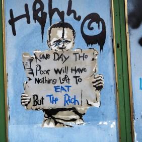 das Bild eines unbekannten Künstlers zeigt einen hungernden Jungen der ein Schild hochhält