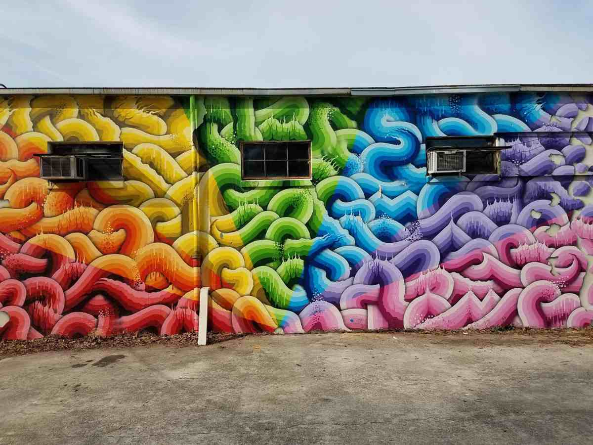 Mural by Ricy Watts featuring multi-clored shapes in Inman Park