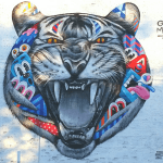 Street art by Greg Mike featuring a tiger composite